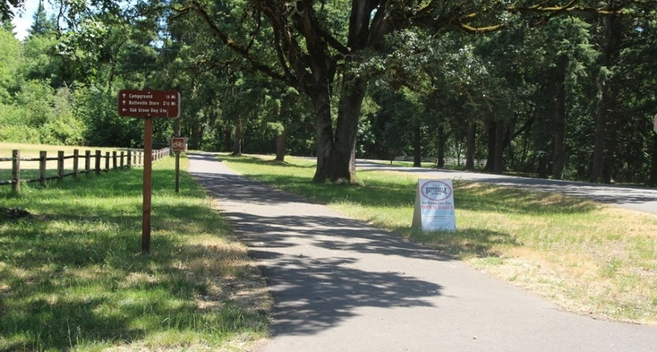 Paved trail to Butteville Store, 2.5 miles with slopes and goes along edge of a road.