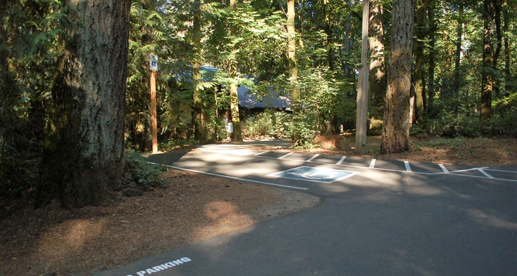 Van accessible parking near with paved path to visitor center and other paved trails.
